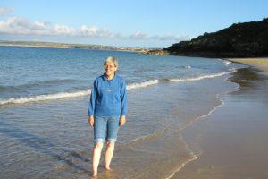 Caroline paddling in the Atlantic at St Ives